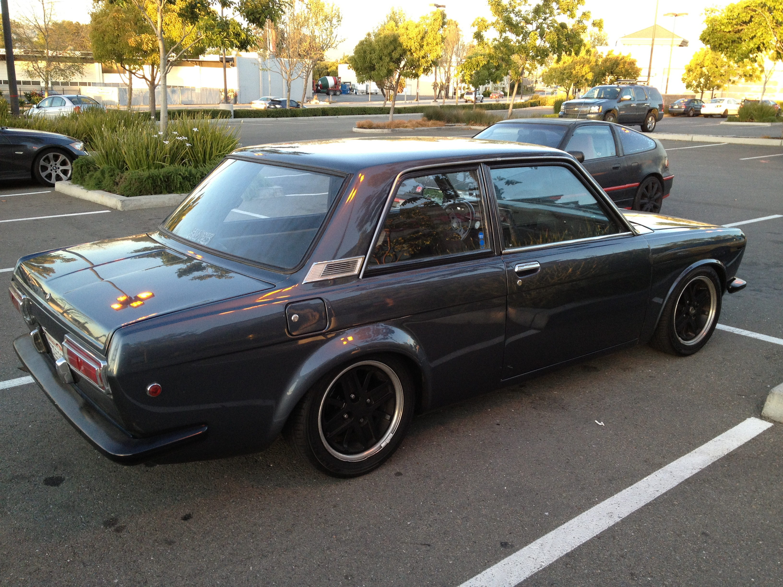 And a gunmetal gray 1969 datsun 510 pulls up just as i do the same